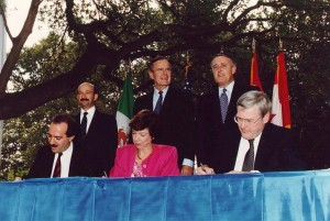 Carla A. Hills was the primary negotiator of the North American Free Trade Agreement (NAFTA).  She is pictured above at the signing ceremony in San Antonio, TX on October 7, 1992.